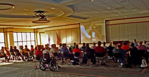 Photo of meeting attendees watching film